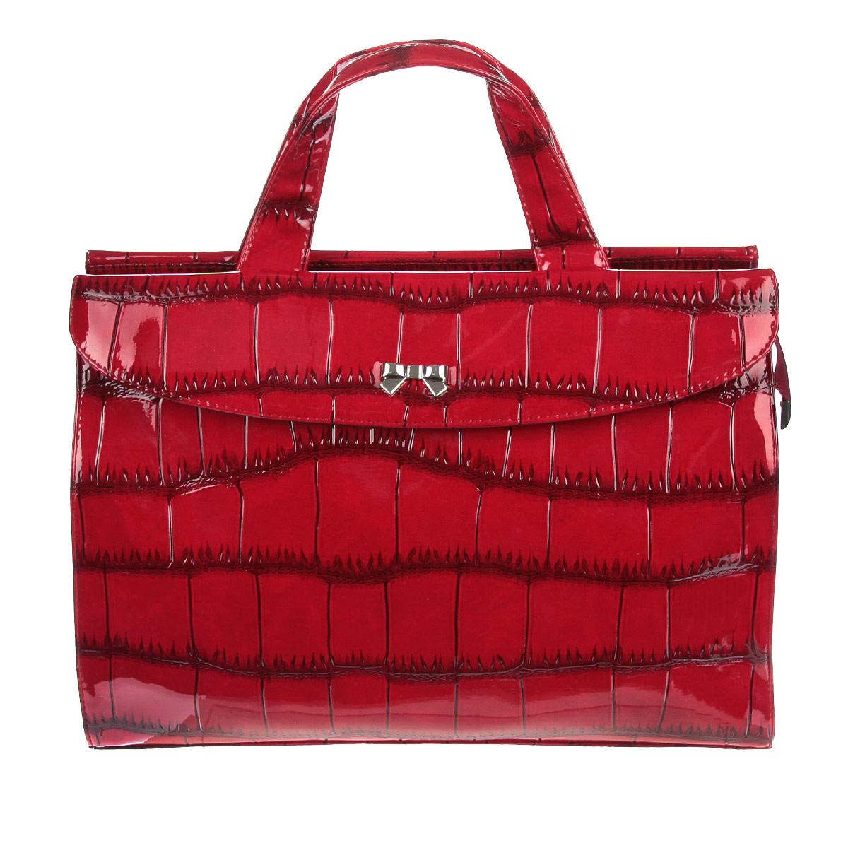 Сумка женская Antan, цвет: красный. 3-53 В3-53 ВОригинальная женская сумка  Antan выполнена из искусственной лакированной кожи, оформлена тиснением под рептилию и кокетливым бантиком серебристого цвета. Модель имеет одно основное отделение, закрывающееся на застежку-молнию. Внутри: два накладных кармана для мелочей и телефона и врезной карман на молнии. В стенках сумки размещены два накладных кармана на магнитных кнопках. Изделие оснащено двумя практичными ручками и плечевым ремнем. Блестящий дизайн сумки, сочетающий классические формы с оригинальным оформлением, позволит вам подчеркнуть свою индивидуальность и сделает ваш образ изысканным и завершенным.