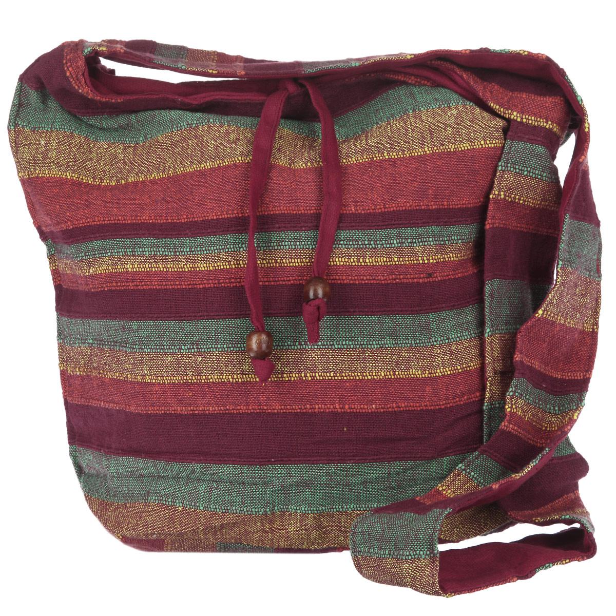 Сумка женская Ethnica, цвет: бордовый, оранжевый, зеленый. 188190188190_бордовая,зеленаяОригинальная женская сумка Ethnica выполнена из хлопка, и оформлена стильными широкими полосками. Сумка состоит из одного основного отделения, закрывающегося на застежку-молнию, и дополнительно фиксирующегося завязками с крупными деревянными бусинами. Внутри расположен открытый кармашек для мелочей. С задней стороны сумки - дополнительный прорезной карман на молнии. Для удобной переноски на плече предусмотрен широкий плечевой ремень. На ремне имеется потайной кармашек на липучке. Такая сумка идеально дополнит и подчеркнет ваш неповторимый образ.