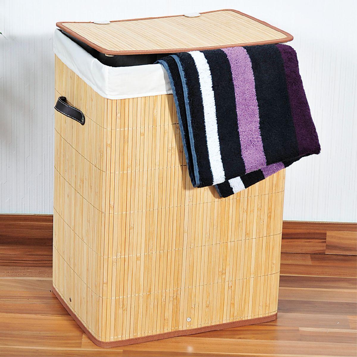 Корзина для белья Kesper, 42 х 32 х 60 см 1955-11955-1Корзина для белья Kesper, выполненная из натурального дерева, предназначена для хранения белья перед стиркой. Корзина очень легко собирается. Внутренний чехол корзины изготовлен из текстиля. Изделие оснащено крышкой и удобными ручками из искусственной кожи. Корзина для белья Kesper - это функциональная и полезная вещь, которая не только сохранит ваше белье, но и стильно украсит интерьер помещения.