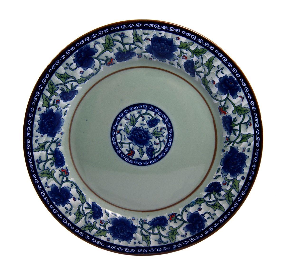 Тарелка для горячего Nanshan Porcelain Харбин, диаметр 25 смGNNSHB027Тарелка Nanshan Porcelain Харбин изготовлена из высококачественной керамики. Предназначена для красивой подачи различных блюд. Посуда безопасна для здоровья и окружающей среды. Внутренние стенки оформлены изящным узором. Такая тарелка украсит сервировку стола и подчеркнет прекрасный вкус хозяйки. Она дополнит коллекцию вашей кухонной посуды и будет служить долгие годы. Можно мыть в посудомоечной машине и использовать в СВЧ. Диаметр: 25 см. Высота: 2 см.