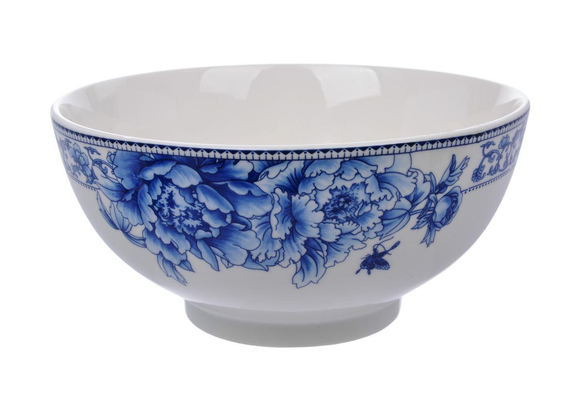 Салатница Nanshan Porcelain Наньшань, цвет: белый, синий, диаметр 20 смGNNSNN005Салатница Nanshan Porcelain Наньшань изготовлена из твердого фарфора с подглазурной деколью, которая защищает рисунок от истирания и продлевает срок эксплуатации посуды. Изделие безопасно для здоровья и окружающей среды, не содержит свинец и кадмий. Внешние стенки оформлены изящным рисунком. Такая салатница прекрасно подходит для холодных и горячих блюд: каш, хлопьев, супов, салатов. Она дополнит коллекцию вашей кухонной посуды и будет служить долгие годы. Можно использовать в посудомоечной машине и СВЧ. Диаметр салатницы (по верхнему краю): 20 см. Высота стенки салатницы: 9,5 см.