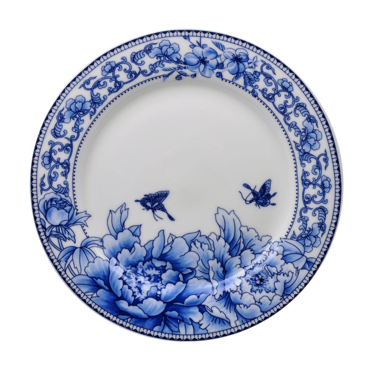 Тарелка для горячего Nanshan Porcelain Наньшань, диаметр 22,5GNNSNN008Тарелка для горячего Nanshan Porcelain Наньшань изготовлена из высококачественной керамики. Предназначена для красивой подачи различных блюд. Изделие декорировано ярким цветочным принтом. Такая тарелка украсит сервировку стола и подчеркнет прекрасный вкус хозяйки. Можно мыть в посудомоечной машине и использовать в СВЧ. Диаметр: 22,5 см. Высота: 2 см.