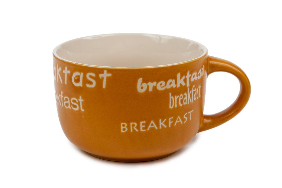 Кружка Wing Star Завтрак, цвет: охра, 460 млLJ7-13B-7411UКружка Wing Star Завтрак изготовлена из керамики и украшена надписями Breakfast. Wing Star - качественная керамическая посуда из обожженной, глазурованной снаружи и изнутри глины с оригинальными рисунками. При изготовлении данной посуды широко используется рельефный способ нанесения декора, когда рельефная поверхность подготавливается в процессе формовки и изделие обрабатывается с уже готовым декором. Благодаря этому достигается эффект неровного на ощупь рисунка, как бы утопленного внутрь глазури и являющегося его естественным элементом. Кружку можно использовать в СВЧ и мыть в посудомоечной машине. Внутренний диаметр: 10,5 см. Высота стенки: 7,5 см. Объем кружки: 460 мл.