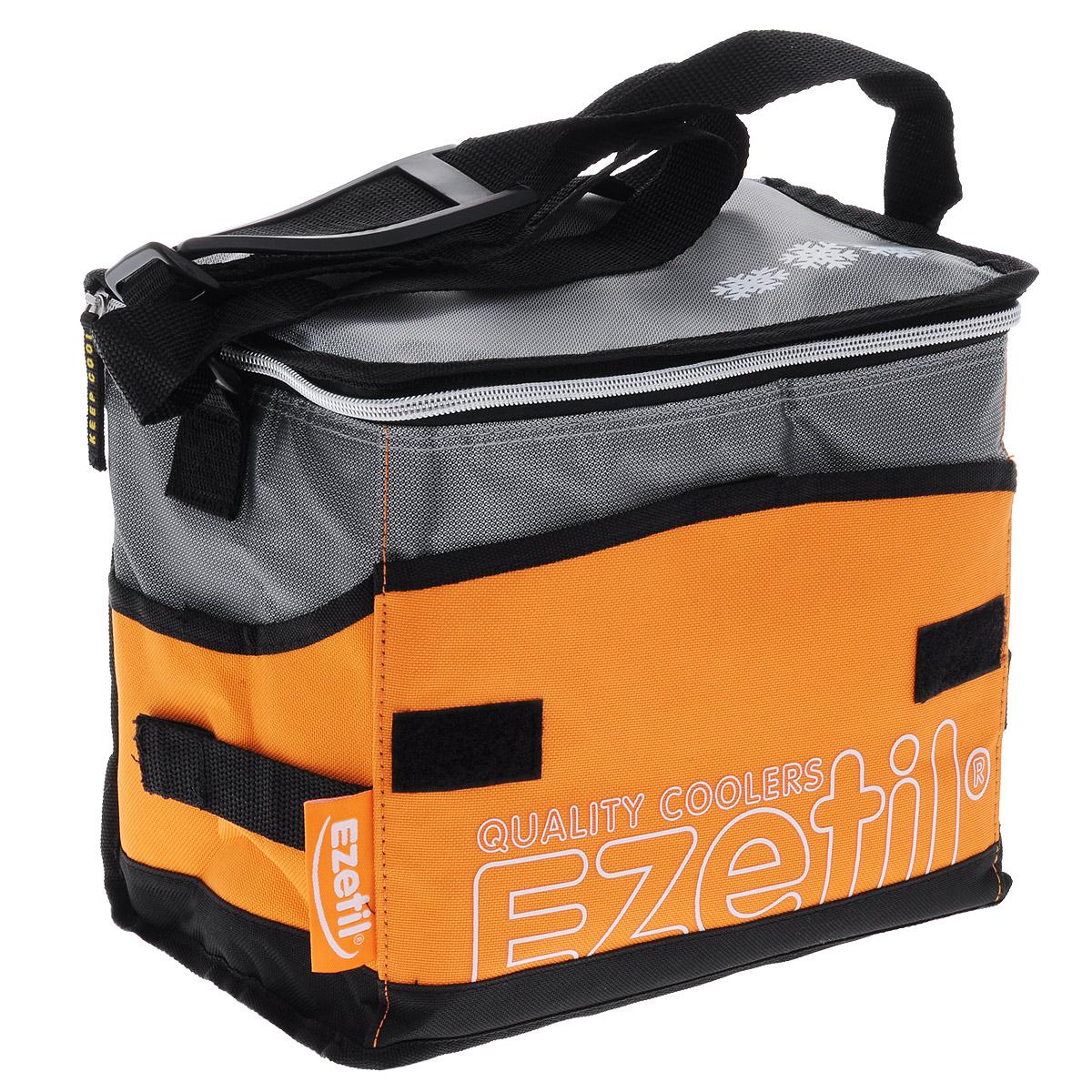 Сумка-холодильник Ezetil KC Extreme, цвет: оранжевый, 16 л726483Сумка-холодильник Ezetil KC Extreme предназначена для транспортировки и хранения продуктов и напитков. Сумка изготовлена из высококачественного полиэстера, внутренняя поверхность отделана специальным термоизоляционным материалом толщиной 8 мм. Внешняя светоотражающая ткань является дополнительным барьером, обеспечивающим надежное удержание холода внутри. Изделие произведено с использованием экологически безопасных и гигиеничных материалов, как внутри, так и снаружи, не содержащих в себе поливинилхлорид. 100% герметичность изотермической сумки обеспечивается современной технологией горячей спайки внутренних швов. Многослойная изоляция обеспечивает надежное удержание температуры помещенных в сумку продуктов при ее максимальном заполнении в течение нескольких часов: от 8 часов без аккумуляторов холода и от 13 часов с комплектами аккумуляторов. Сумка фиксируется в сложенном состоянии, имеет съемное дно и практична в уходе. Застегивается на застежку-молнию, снаружи...