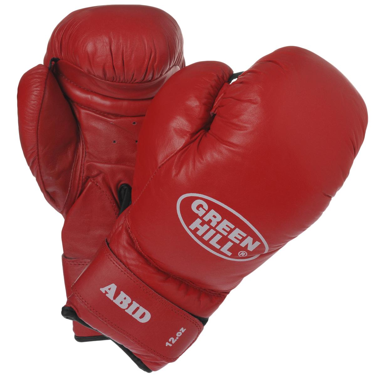 Перчатки боксерские Green Hill Abid, цвет: красный. Вес 12 унцийBGA-2024Боксерские тренировочные перчатки Green Hill Abid выполнены из натуральной кожи. Они отлично подойдут для начинающих спортсменов. Мягкий наполнитель из очеса предотвращает любые травмы. Широкий ремень, охватывая запястье, полностью оборачивается вокруг манжеты, благодаря чему создается дополнительная защита лучезапястного сустава от травмирования. Застежка на липучке способствует быстрому и удобному одеванию перчаток, плотно фиксирует перчатки на руке.