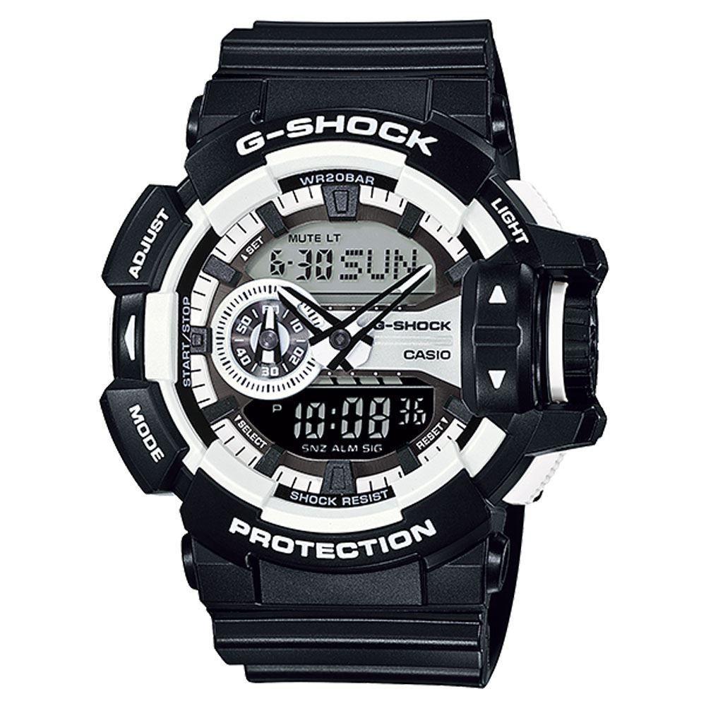 Часы мужские наручные Casio G-SHOCK, цвет: черный, белый. GA-400-1AGA-400-1AСтильные мужские часы Casio G-SHOCK выполнены из полимерных материалов и минерального стекла. Изделие дополнено светодиодной подсветкой высокой яркости, корпус часов оформлен символикой бренда. В часах предусмотрен аналоговый и цифровой отсчет времени. Часы оснащены функцией мирового времени, которая позволяет мгновенно выяснять текущее время. Часы могут быть настроены на подачу тонального или светового сигнала при наступлении выставленного времени. Функция таймера позволит обеспечить обратный отсчет времени, начиная с выставленного и подачу тонального или светового сигнала, когда отсчет доходит до нуля. Функция секундомера позволит замерять прошедшее время в пределах тысячи часов с точностью 1/100 секунды. Степень влагозащиты 20 atm. Изделие дополнено ремешком из полимерного материала, который обладает антибактериальными и запахоустойчивыми свойствами. Ремешок застегивается на пряжку, позволяющую максимально комфортно и быстро снимать и одевать часы. Часы поставляются в...