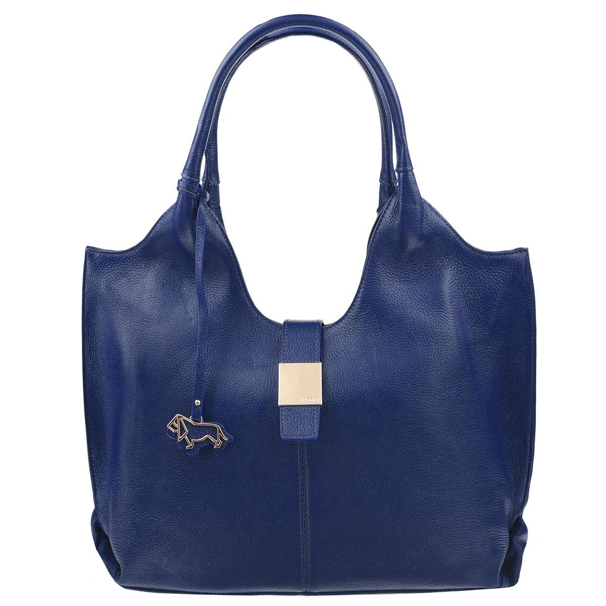 Сумка женская Labbra, цвет: синий. L-DL90389-1L-DL90389-1Элегантная женская сумка Labbra выполнена из натуральной кожи сочного оттенка. Лицевая сторона сумки дополнена металлическим элементом с логотипом бренда и подвеской. Изделие содержит одно основное отделение, закрывающееся на застежку-молнию, дополнительно закрывается на магнитную кнопку. Внутри - врезной карман на молнии, два накладных кармашка для мобильного телефона и мелочей, два дополнительных накладных кармана, один из них на молнии. Сумка оснащена практичными и удобными ручками. Дно сумки защищено металлическими ножками, которые уберегут изделие от повреждений. Стильная сумка позволит вам подчеркнуть свою индивидуальность, и сделает ваш образ изысканным и завершенным.