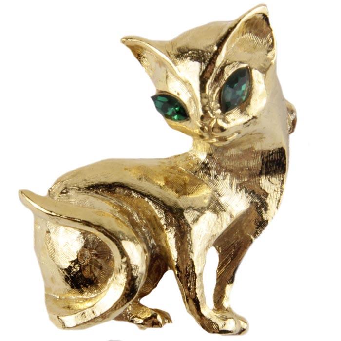 Винтажная брошь Египетская кошка №2. Ювелирный сплав, кристаллы. Конец XX века19/0112Винтажная брошь Египетская кошка. Ювелирный сплав, кристаллы. Западная Европа, конец ХХ века. Размер броши 5,5 х 3. Сохранность хорошая. На обороте брошь имеет каталожный номер компании производителя. Винтажное украшение прекрасного качества. Брошь выполнена из высококачественного ювелирного сплава. Поверхность броши ребристая, блестящая, имитирующая шерстку животного. Глазки - два несомненно чудесных кристалла изумрудного цвета в форме эллипса. Брошь для истинных ценителей винтажных украшений. Аксессуар, несомненно, станет и необычным и прекрасным дополнением вашего наряда.