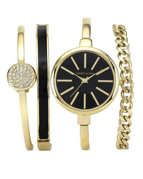 Часы наручные женские Anne Klein 1470GBST, цвет: черный, золотой1470GBSTКорпус: металл, PVD покрытие, 32 мм, стекло: минеральное, браслет: металл, PVD покрытие, 3 дополнительных браслета, механизм: кварцевый, водозащита: 3 АТМ
