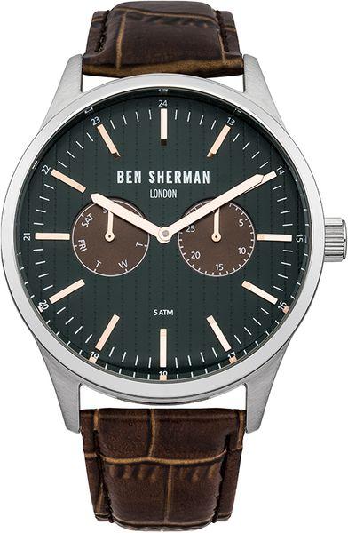Часы мужские наручные Ben Sherman WB024BR, цвет: стальной, коричневый,зеленый. WB024BRWB024BRСтильные мужские часы Ben Sherman выполнены из нержавеющей стали, натуральной кожи и минерального стекла. Изделие оформлено символикой бренда. Часы оснащены кварцевым механизмом с двумя стрелками, полированным корпусом, устойчивым к царапинам минеральным стеклом, степенью влагозащиты 5atm, двумя дополнительными циферблатами с индикаторами даты. Изделие дополнено ремешком из натуральной кожи с тиснением под рептилию и практичной пряжкой, позволяющей максимально комфортно и быстро снимать и одевать часы. Часы поставляются в фирменной упаковке. Часы Ben Sherman подчеркнут мужской характер и отменное чувство стиля их обладателя.