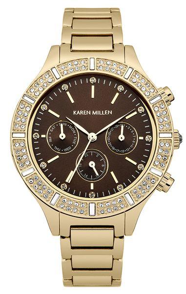 Часы наручные женские Karen Millen, цвет: золотой. KM103GMKM103GMЭлегантные женские часы Karen Millen изготовлены из нержавеющей стали с IP-покрытием и минерального стекла. Циферблат и корпус часов оформлены символикой бренда и кристаллами Swarovski. Корпус изделия оснащен кварцевым механизмом, который имеет степень влагозащиты равную 5 Bar, дополнен устойчивым к царапинам минеральным стеклом. Браслет оснащен замком-бабочкой, который позволит с легкостью снимать и надевать изделие. Часы поставляются в фирменной упаковке. Часы Karen Millen подчеркнут изящность женской руки и отменное чувство стиля у их обладательницы.