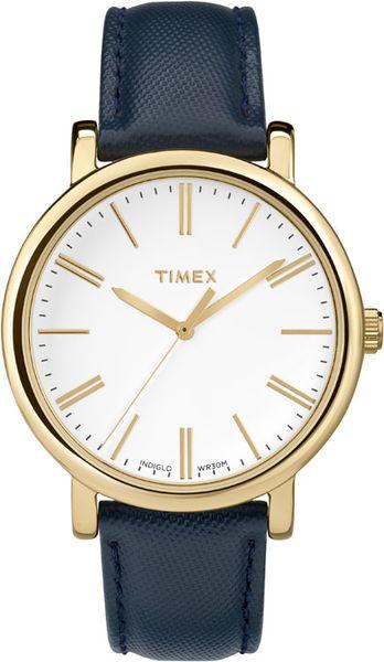 Часы наручные женские Timex, цвет: золотистый, синий. TW2P63400TW2P63400Стильные женские наручные часы Timex выполнены из нержавеющей стали с золотистым покрытием. Циферблат изделия оформлен отметками, часовой, минутной и секундной стрелками. Также циферблат дополнен логотипом Timex. Часы оснащены кварцевым механизмом, устойчивым к царапинам минеральным стеклом и подсветкой циферблата Indiglo. Модель обладает степенью влагозащиты 3 atm. Изделие дополнено ремешком из натуральной с тиснением, позволяющим максимально комфортно и быстро снимать и одевать часы при помощи пряжки. Часы поставляются на специальной подушечке в стильной коробке с логотипом Timex. Стильные часы станут отличным дополнением к вашему образу.