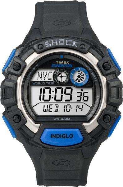 Часы наручные мужские Timex Expedition World Shock, цвет: синий, черный. TW4B00400TW4B00400Стильные мужские наручные часы Timex Expedition World Shock с противоударным корпусом, выполнены из пластика. Изделие имеет электронный циферблат. Часы оснащены кварцевым механизмом, устойчивым к царапинам пластиковым стеклом и подсветкой циферблата Indiglo. Также часы оснащены индикатором дня, месяца и дня недели, таймером обратного отсчета, функцией отображения мирового времени, сплит-хронографом на 100 часов с памятью на 30 кругов и будильником с функцией Snooze. Модель обладает степенью влагозащиты 10 atm. Изделие дополнено ремешком из каучука, позволяющим максимально комфортно и быстро снимать и одевать часы при помощи пряжки. Часы поставляются в фирменной коробке. Функциональные часы в спортивном стиле для мужчин, уверенных в своих силах.