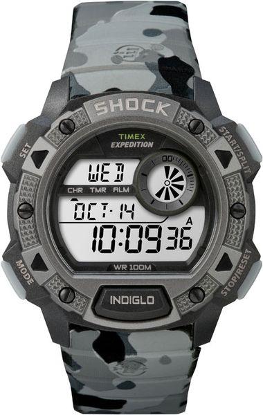Часы наручные мужские Timex Expedition Base Shock, цвет: черный, серый. TW4B00600 - TimexTW4B00600Стильные мужские наручные часы Timex Expedition Base Shock с противоударным корпусом, выполнены из пластика. Изделие имеет электронный циферблат. Часы оснащены кварцевым механизмом, устойчивым к царапинам пластиковым стеклом и подсветкой циферблата Indiglo. Также часы оснащены индикатором дня, месяца и дня недели, таймером обратного отсчета, функцией отображения мирового времени, сплит-хронографом на 100 часов с памятью на 30 кругов и будильником. Модель обладает степенью влагозащиты 10 atm. Изделие дополнено ремешком из каучука, позволяющим максимально комфортно и быстро снимать и одевать часы при помощи пряжки. Часы поставляются в фирменной коробке. Функциональные часы в стиле милитари для мужчин, уверенных в своих силах.