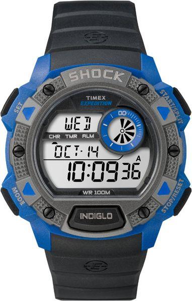 Часы наручные мужские Timex Expedition Shock, цвет: синий, серый, черный. TW4B00700TW4B00700Стильные мужские наручные часы Timex Expedition Shock с противоударным корпусом, выполнены из пластика. Изделие имеет электронный циферблат. Часы оснащены кварцевым механизмом, устойчивым к царапинам пластиковым стеклом и подсветкой циферблата Indiglo. Также часы оснащены индикатором дня, месяца и дня недели, таймером обратного отсчета, функцией отображения второго часового пояса, сплит-хронографом на 100 часов с памятью на 30 кругов и будильником с функцией Snooze. Модель обладает степенью влагозащиты 10 atm. Изделие дополнено ремешком из каучука, позволяющим максимально комфортно и быстро снимать и одевать часы при помощи пряжки. Часы поставляются в фирменной коробке. Функциональные часы в спортивном стиле для мужчин, уверенных в своих силах.