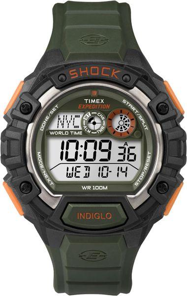 Часы наручные мужские Timex Expedition Shock, цвет: зеленый, черный, серый. T49972T49972Стильные мужские наручные часы Timex Expedition Shock с противоударным корпусом, выполнены из пластика. Изделие имеет электронный циферблат. Часы оснащены кварцевым механизмом, устойчивым к царапинам пластиковым стеклом и подсветкой циферблата Indiglo. Также часы оснащены индикатором дня, месяца и дня недели, таймером обратного отсчета, функцией отображения мирового времени, сплит-хронографом на 100 часов с памятью на 30 кругов и будильником с функцией Snooze. Модель обладает степенью влагозащиты 10 atm. Изделие дополнено ремешком из каучука, позволяющим максимально комфортно и быстро снимать и одевать часы при помощи пряжки. Часы поставляются в фирменной коробке. Функциональные часы в спортивном стиле для мужчин, уверенных в своих силах.