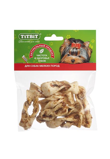 Лакомство для собак Titbit, плетенки из говяжьей кожи319908Высушенные кусочки говяжьей кожи неправильной формы в обсыпке из молотых говяжьих кишок. Благодаря большому содержанию аминокислот и коллагена положительно воздействует на хрящевую ткань, состояние кожи и шерсти собаки. Благодаря волокнистой структуре являются своеобразной зубной щёткой, способствующей укреплению дёсен, удалению зубного налёта и профилактике образования зубного камня. Состав: Высушенная говяжья кожа.