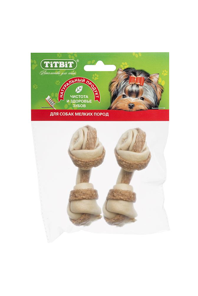 Лакомство для собакTitbit, кость узловая №2, с мясом курицы, 2 шт3237Высушенная говяжья кожа, свернутая в форме кости размером 90-110 мм с прослойкой начинки из мяса курицы. В упаковке 2 штуки. Благодаря большому содержанию аминокислот и коллагена положительно воздействует на состояние кожи и шерсти собаки, а также обеспечивает поступление в организм незаменимых компонентов для роста и поддержания качества хрящевой ткани суставов собак. Начинка из куриного мяса богата ценными пищевыми ферментами, каротином, биотином и витаминами А, Е, С, В6, В12. Содержит в достаточном количестве такие полезные минеральные вещества, как фосфор, железо, медь и цинк. Состав: Высушенная говяжья кожа, мясные субпродукты.