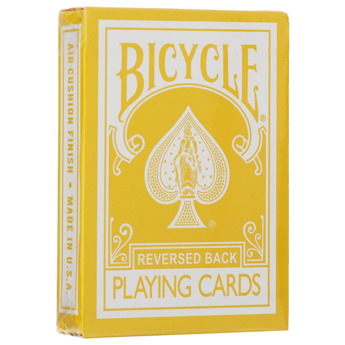 Карты игральные Bicycle Reversed Back, цвет: желтыйК-221Игральные карты Bicycle Reversed Back станут прекрасным подарком для всех любителей карточных игр. Карты этой оригинальной колоды имеют стильный и реалистичный старинный вид. Такие карты подходят для фокусов, покера и любых других карточных игр. Идеальный вариант как для новичков, так и для профессионалов. Кроме 52 стандартных карт в этой колоде вы найдете 4 дополнительных специальных карты, которые вознесут вас к вершинам мастерства.