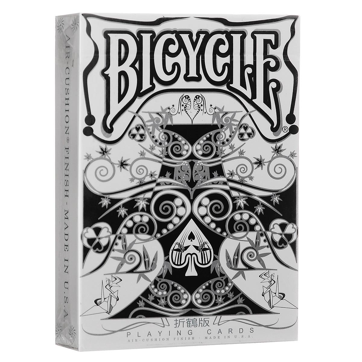 Игральные карты Bicycle Преобразователь, цвет: серебряный, белый, черныйК-421Игральные карты Bicycle Преобразователь посвящены японской культуре. Основная тема данной колоды - Oriduru. Oriduru - это бумажные журавлики, сложенные из бумаги оригами. Древняя японская легенда гласит, что тот кто сложит тысячу таких журавликов обретет счастье. Уникальное сочетание цветов рубашки (серебряный, белый, черный) обеспечивает 3D картинку на изображении.