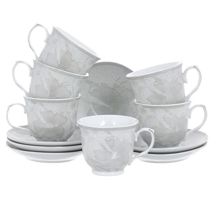 Набор чайный House & Holder, цвет: серебристый, 12 предметов. DP-D18-D2DP-D18-D2Чайный набор House & Holder состоит из шести чашек и шести блюдец, выполненных из высококачественного фаянса. Внешняя поверхность предметов набора шероховатая. Изделия серебристого цвета оформлены изящным цветочным рисунком. Изящный набор эффектно украсит стол к чаепитию и порадует вас функциональностью и ярким дизайном. Объем чашки: 250 мл. Диаметр (по верхнему краю): 9 см. Высота чашки: 7,5 см. Диаметр блюдца: 14 см.