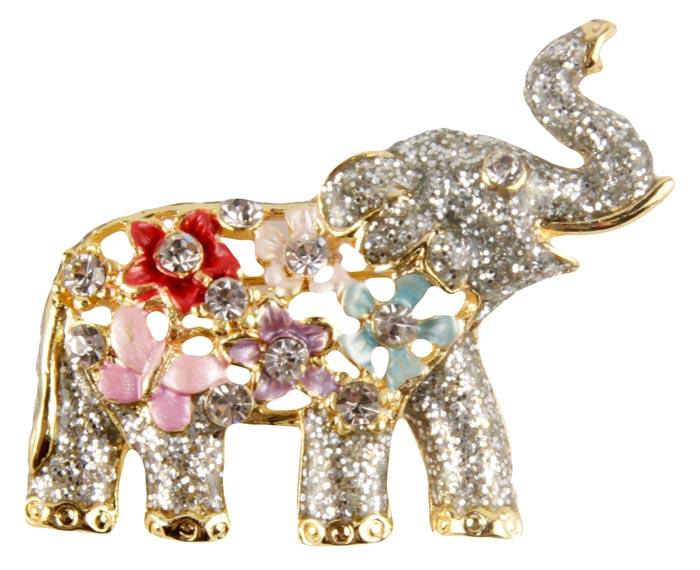 Брошь Слон в цветочной попоне. Бижутерный сплав, лак, австрийские кристаллы. Конец XX векаk285f316Брошь Слон в цветочной попоне. Бижутерный сплав, лак, австрийские кристаллы. Конец XX века. Размеры 4,5 х 2,5 см. Сохранность хорошая. Очаровательная яркая брошка в виде слона с поднятым хоботом. Аксессуар сделан из золотого металлического сплава. Изделие украшено лаком блестящего серебристого оттенка. Попона у слона украшена яркими цветами и красивейшими кристаллами прозрачного оттенка. Глаз у слоника прозрачный кристалл. . Эта красивая брошь станет отличным украшением и гармонично дополнит Ваш наряд, станет завершающим штрихом в создании образа. Слон как символ мудрости, семьи и счастья принесет вам удачу и хорошее настроение.