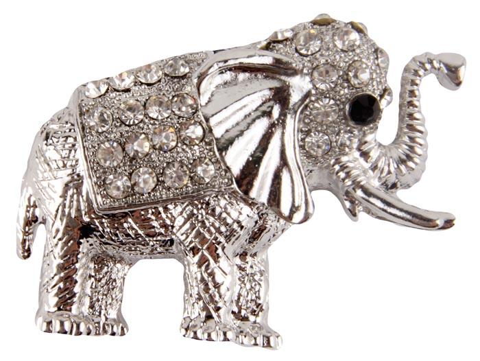 Брошь Серебряный слон. Бижутерный сплав, австрийские кристаллы. Конец XX века19/0112Брошь Серебряный слон. Бижутерный сплав, австрийские кристаллы. Конец XX века. Размеры 5 х 3 см. Сохранность хорошая. Очаровательная яркая брошка в виде слона с поднятым хоботом. Аксессуар сделан из серебристого металлического сплава, поверхность металла фактурная, ребристая, имитирующая шерсть животного. Попона и голова слона украшены кристаллами прозрачного цвета. Глазик у слона из кристаллика черного цвета. Эта красивая брошь станет отличным украшением и гармонично дополнит Ваш наряд, станет завершающим штрихом в создании образа. Слон как символ мудрости, семьи и счастья принесет вам удачу и хорошее настроение.