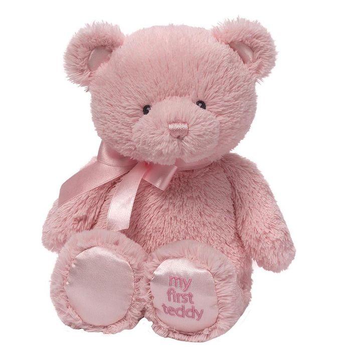 Игрушка мягкая Gund My First Teddy, цвет: розовый, 27 см. 40439494043949Очаровательная мягкая игрушка Мой первый мишка не оставит вас равнодушным и вызовет улыбку у каждого, кто ее увидит. Игрушка выполнена из полиэстера в виде милого медвежонка с бантиком на шее. Милые, мягкие и безопасные, игрушки фирмы Gund отличаются реалистичным внешним видом, напоминающим настоящего питомца. Только посмотрите на эту милую мордашку, которая так приветливо смотрит на вас. Разве можно устоять перед ее обаянием? Конечно нет, да и не нужно! Такая игрушка вызывает умиление не только у детей, но и у взрослых. Поэтому она станет отличным подарком не только ребенку, но и друзьям!
