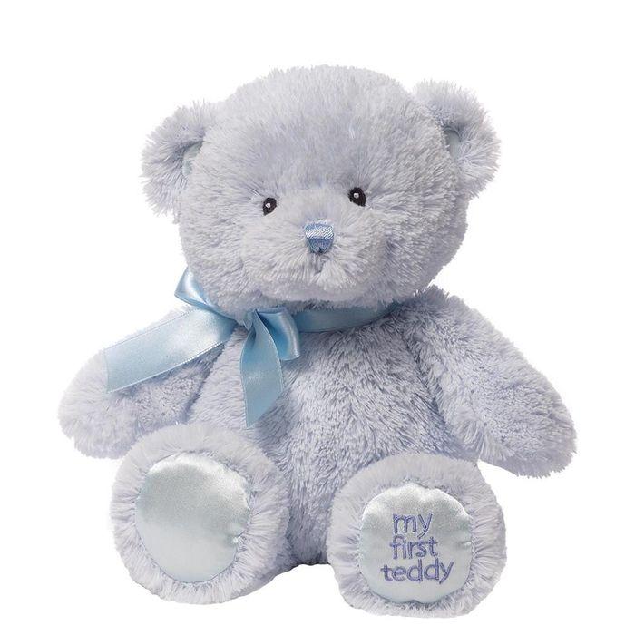 Игрушка мягкая Gund My First Teddy, цвет: голубой, 27 см. 40439504043950Очаровательная мягкая игрушка Мой первый мишка не оставит вас равнодушным и вызовет улыбку у каждого, кто ее увидит. Игрушка выполнена из голубого полиэстера в виде милого медвежонка с бантиком на шее. Милые, мягкие и безопасные, игрушки фирмы Gund отличаются реалистичным внешним видом, напоминающим настоящего питомца. Только посмотрите на эту милую мордашку, которая так приветливо смотрит на вас. Разве можно устоять перед ее обаянием? Конечно нет, да и не нужно! Такая игрушка вызывает умиление не только у детей, но и у взрослых. Поэтому она станет отличным подарком не только ребенку, но и друзьям!