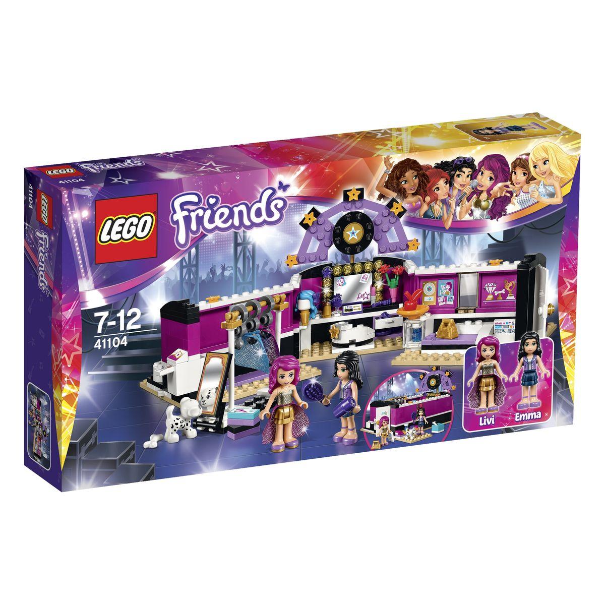 LEGO Friends Конструктор Поп звезда Гримерная 4110441104Гримерная комната из набора LEGO 41104 понравится каждой, даже самой требовательной певице. В ней есть всё необходимое для создания сценического образа и подготовки к выступлению. Комната представляет собой прямоугольное помещение с розово-черными стенами и огромной вывеской со звездами. Чтобы попасть внутрь, можно воспользоваться белой входной дверью, а для более реалистичной игры - использовать функцию трансформации, превращающую гримерную в просторный зал. Центральное место в интерьере отведено будуару с вытянутой столешницей, на которой видна ваза с цветами, косметическая палитра, духи, помада, фен, расческа, подставка для парика и множество аксессуаров для волос. Благодаря вращающемуся креслу и большому зеркалу с подсветкой поп-звезда может детально рассмотреть свой макияж и прическу. Слева от будуара устроена гардеробная зона. В ней есть штанга для вешалок со сценическими костюмами, коробки с туфлями, а также ростовое зеркало, позволяющее рассмотреть наряд со всех сторон....