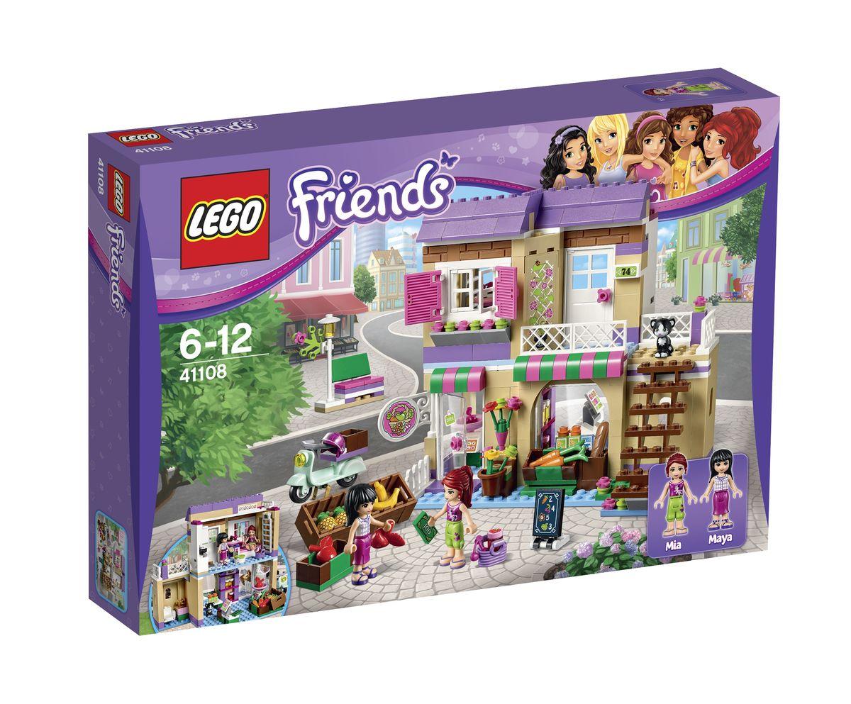 LEGO Friends Конструктор Продуктовый рынок 4110841108Чтобы приобрести самые свежие овощи и фрукты, необходимо заглянуть на продуктовый рынок из набора Лего 41108. Здесь, на оживленной городской улице вы найдете двухэтажный дом с бежевыми стенами, фиолетовой крышей, стеклянной дверью и вывеской. Это дом Майи! Перед его входом всегда видны ящики с самыми сладкими бананами, ананасами, яблоками и морковью. Внутри магазина тоже есть полки с товарами, на которых выставлены пакеты с молоком, баночки с джемом, свежевыпеченный хлеб и пакеты с апельсиновым соком. Для оплаты покупок можно использовать точные весы и кассовый аппарат. Рядом с магазином оборудован небольшой санузел с унитазом и раковиной. На втором этаже здания располагается уютная квартира Майи с распашными ставнями и открывающимися окошками. Чтобы попасть внутрь, необходимо подняться по внешней деревянной лестнице. Интерьер комнаты разделен на две зоны. Справа устроен кухонный уголок с плитой, духовкой и шкафчиками для хранения посуды, а слева - спальня с мягким диваном,...