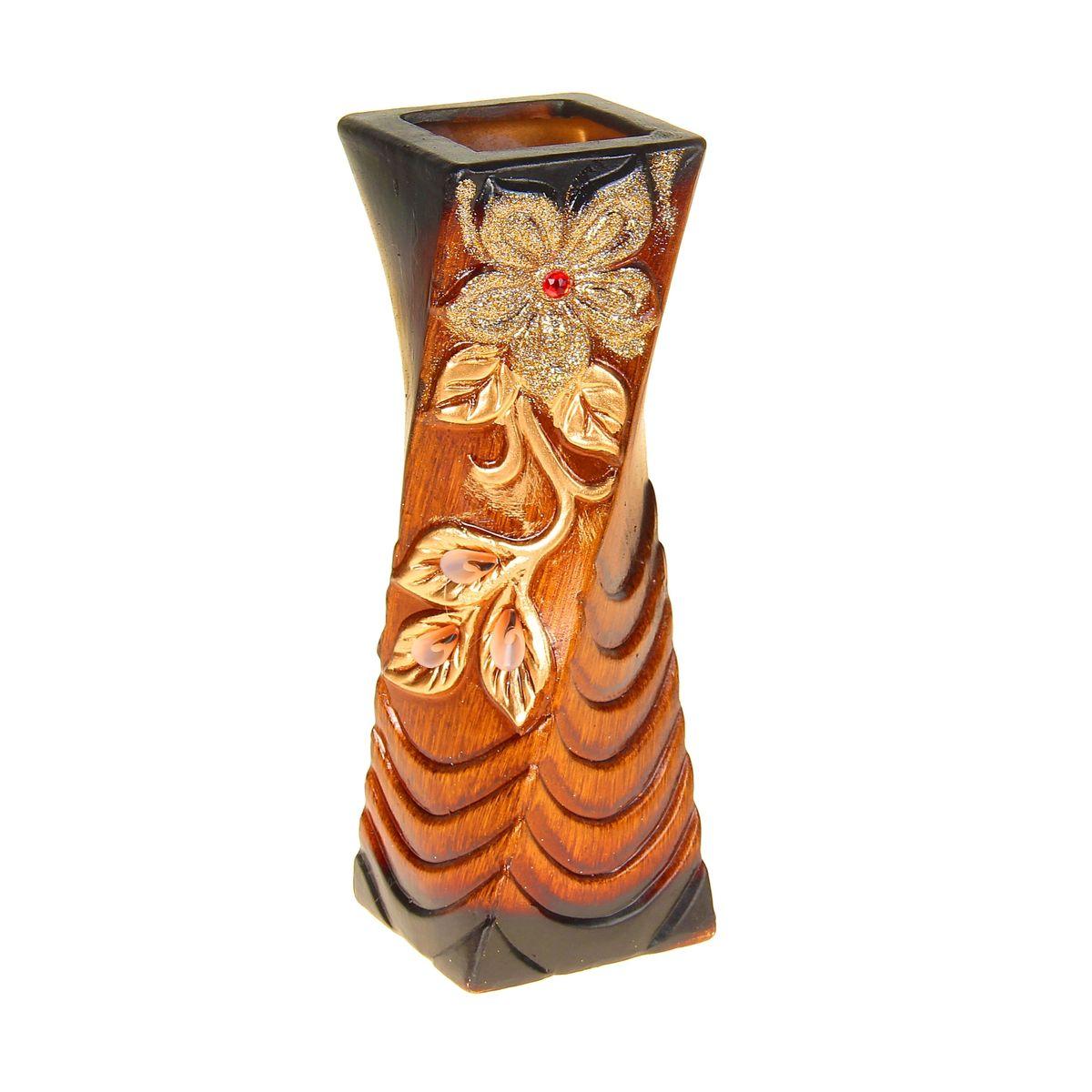 Ваза Sima-land Цветок. Кристалл, цвет: коричневый, золотой, высота 30,5 см1044975Ваза Sima-land Цветок. Кристалл изготовлена из прочной керамики. Изделие оформлено рельефным изображением цветка и декорировано блестками. Такая изящная ваза с легкостью впишется практически в любой интерьер. Она станет изумительным подарком, который доставит радость, ведь это не только красивый, но еще и функциональный презент. Размер по верхнему краю: 10 см х 10 см.