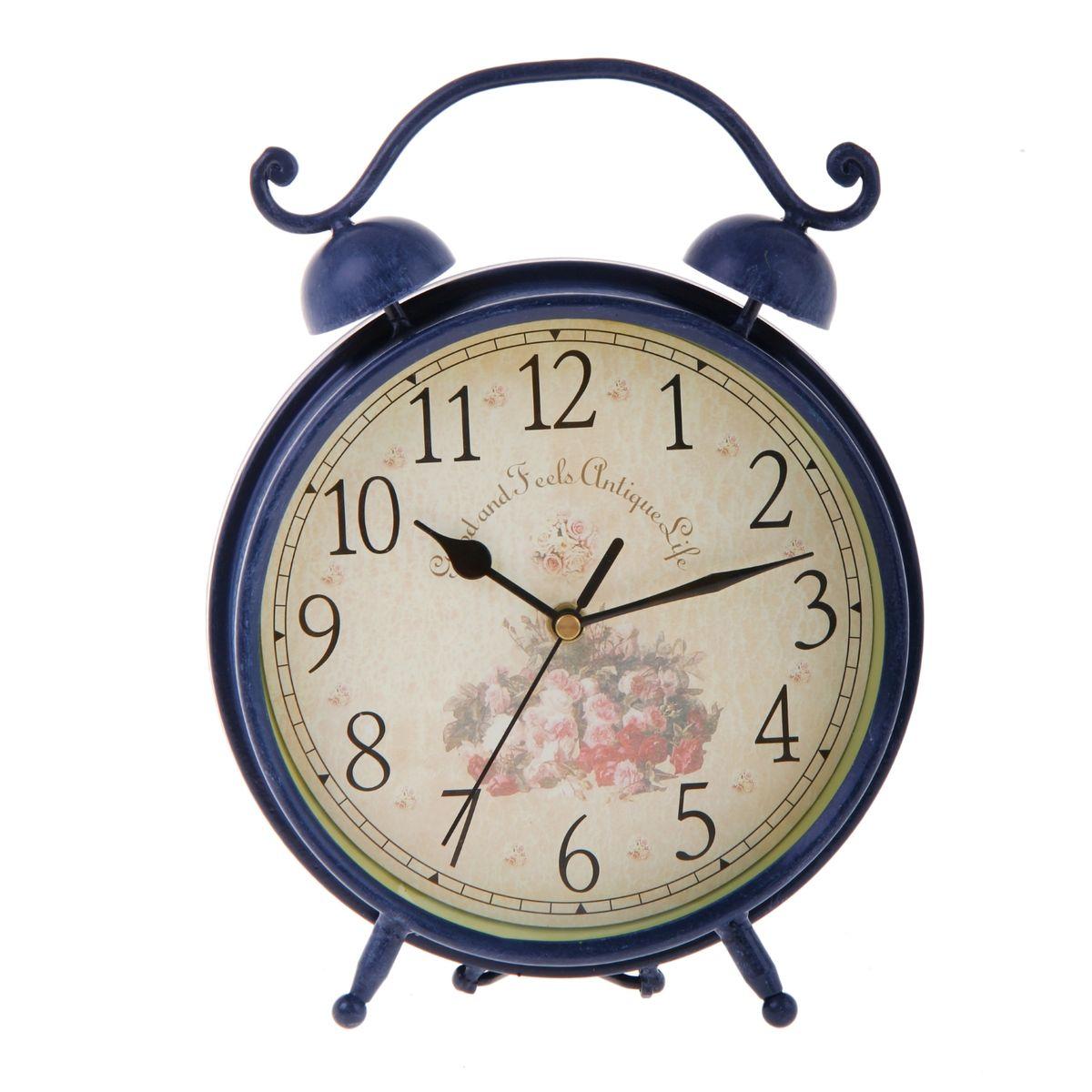 Часы настольные Sima-land, цвет: синий. 670128670128Настольные часы Sima-land станут оригинальным элементом декора в доме или офисе. Часы, изготовленные из высококачественного металла и стекла, выполнены в виде будильника. Циферблат круглой формы, имеет крупные арабские цифры. Часы имеют три стрелки - часовую, минутную и секундную. Изделие располагается на металлических ножках. Настольные часы Sima-land станут не только оригинальным украшением стола, но и прекрасным подарком, который обязательно понравится получателю. Часы работают от одной батарейки с напряжением 1,5 V (в комплект не входит). Диаметр циферблата: 18,5 см. Общий размер часов: 20 см х 7,5 см х 26,5 см.