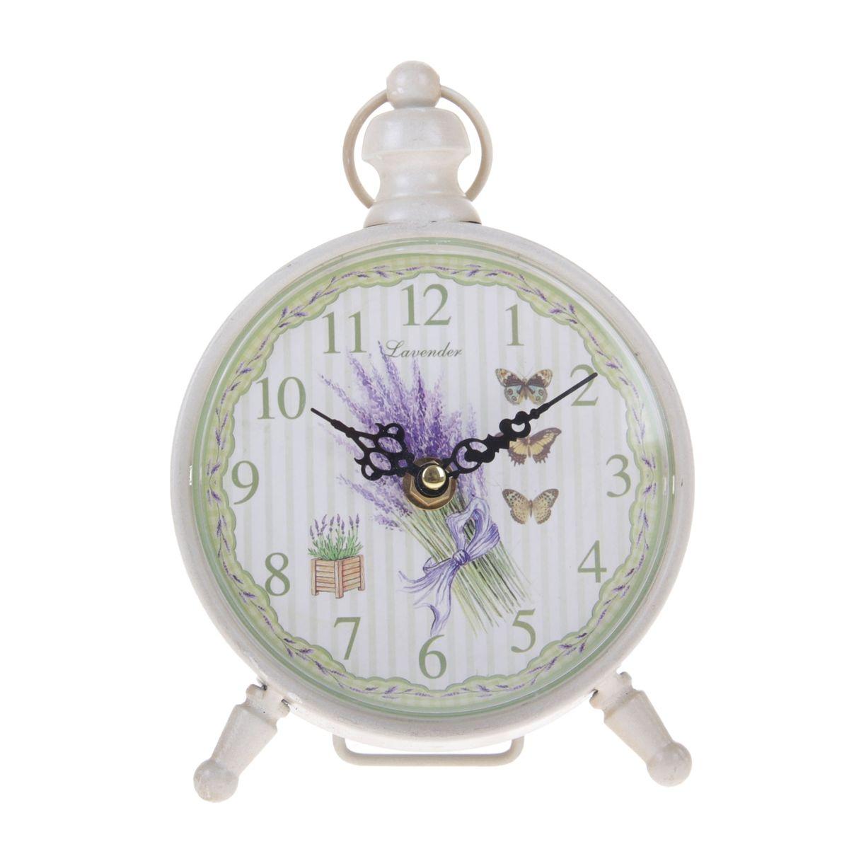 Часы настольные Sima-land Лаванда и бабочки840839Настольные часы Sima-land Лаванда и бабочки станут оригинальным элементом декора в доме или офисе. Часы, изготовленные из высококачественного металла и пластика, выполнены в виде будильника. Циферблат круглой формы, имеет крупные арабские цифры. Часы имеют две стрелки - часовую и минутную. Изделие располагается на металлических ножках. Настольные часы Sima-land Лаванда и бабочки станут не только оригинальным украшением стола, но и прекрасным подарком, который обязательно понравится получателю. Часы работают от одной батарейки с напряжением 1,5 V (в комплект не входит). Диаметр циферблата: 12,5 см. Общий размер часов: 20 см х 7 см х 18,5 см.