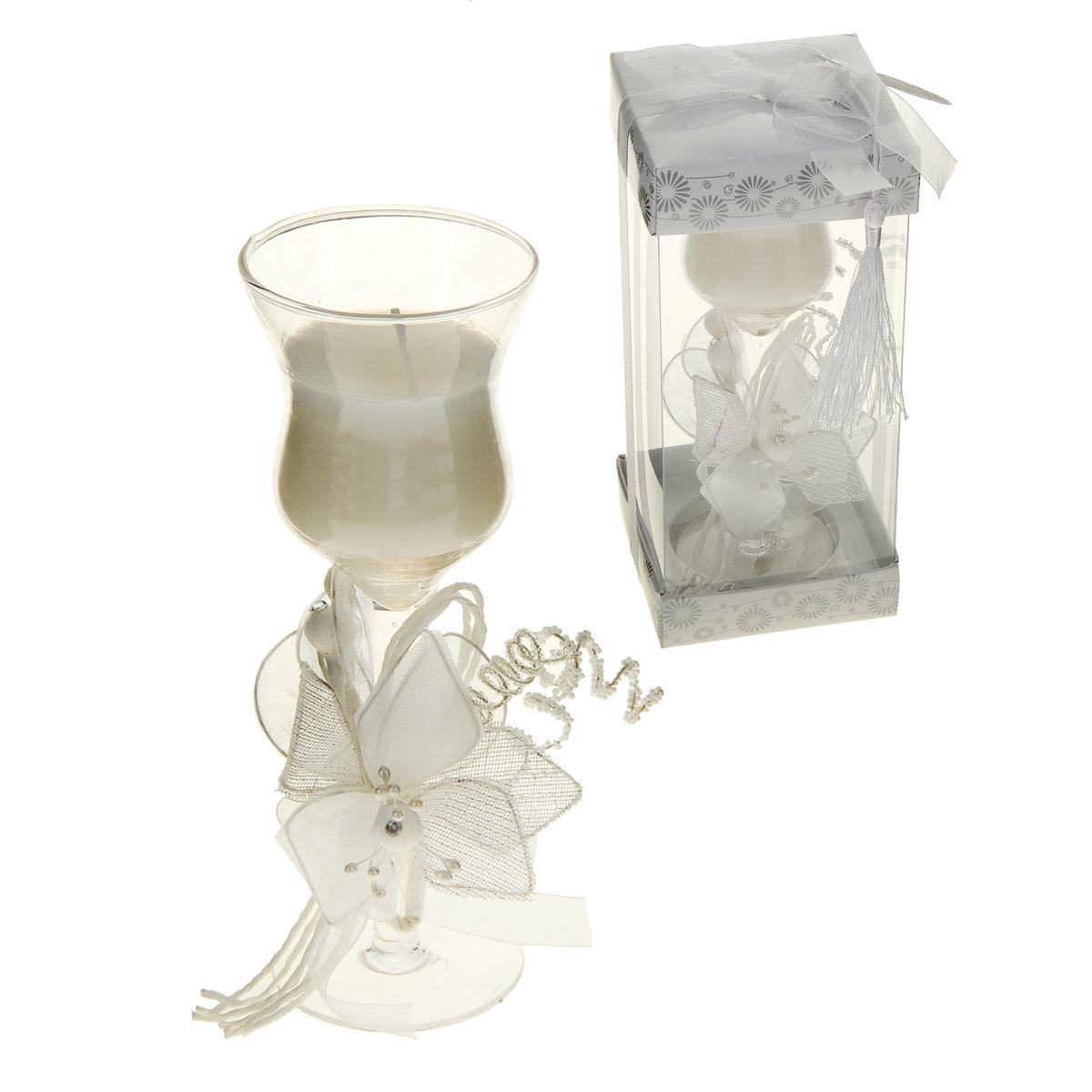 Свеча декоративная Sima-land Цветок искренности, цвет: белый, высота 17,5 см846523Свеча Sima-land Цветок искренности изготовлена из воска и поставляется в подсвечнике в виде красивого фужера, оформленного текстильным бантом и декоративными элементами. Такая свеча может стать отличным подарком или дополнить интерьер вашей комнаты.