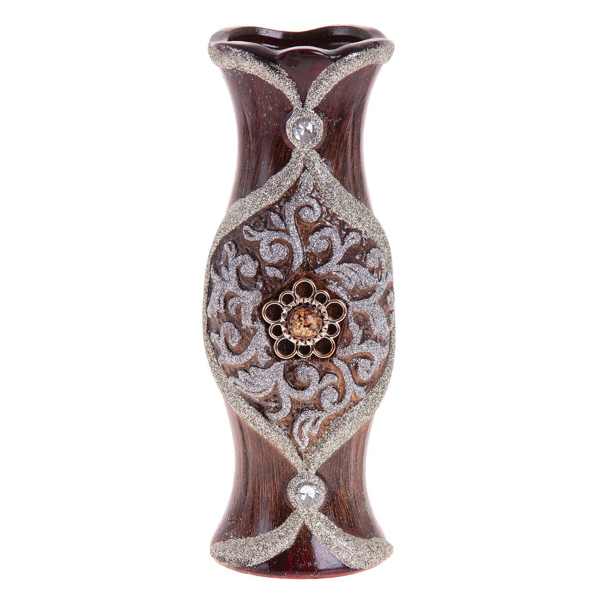 Ваза Sima-land Брошка, цвет: коричневый, серебристый, высота 30 см913542Ваза Sima-land Брошка изготовлена из высококачественной керамики и декорирована блестками и пластиковой брошкой. Интересная форма и необычное оформление сделают эту вазу замечательным украшением интерьера. Ваза предназначена как для живых, так и для искусственных цветов. Любое помещение выглядит незавершенным без правильно расположенных предметов интерьера. Они помогают создать уют, расставить акценты, подчеркнуть достоинства или скрыть недостатки.