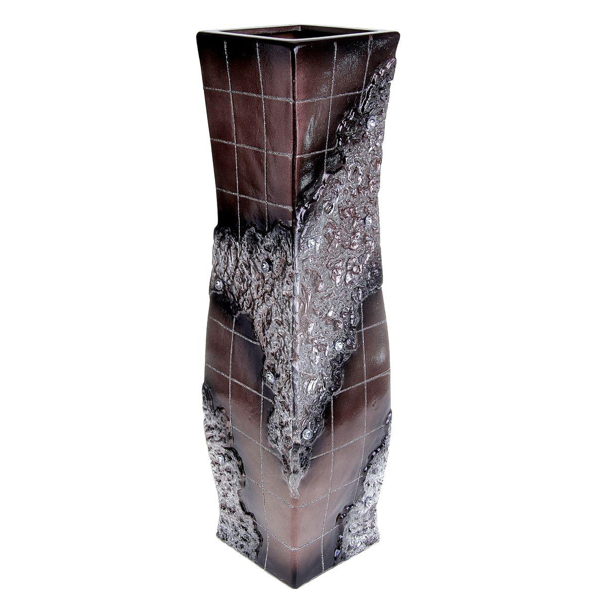 Ваза напольная Sima-land Цветочная плитка, высота 60 см913548Напольная ваза Sima-land Цветочная плитка, выполненная из керамики, станет изысканным украшением интерьера. Она предназначена как для живых, так и для искусственных цветов. Изделие декорировано блестками и стразами. Интересная форма и необычное оформление сделают эту вазу замечательным украшением интерьера. Любое помещение выглядит незавершенным без правильно расположенных предметов интерьера. Они помогают создать уют, расставить акценты, подчеркнуть достоинства или скрыть недостатки.