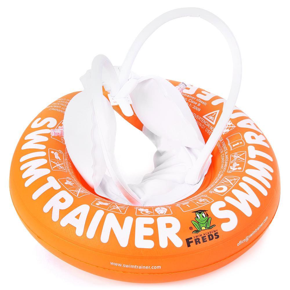 Круг надувной Swimtrainer Classic, от 2 до 6 лет, цвет: оранжевый. 1022010220Надувной круг Swimtrainer Classic изготовлен из ПВХ. Круг состоит из 5 независимых надувных камер. Помогает удерживать правильное положение тела в воде. Благодаря специальной системе крепления, ваш ребенок не выскользнет из круга. Круг подходит для детей 2-6 лет. Основная задача круга - обучение правильным движениям ног, затем - рук, а затем - их совместным скоординированным движениям. С кругом Swimtrainer Classic обучение плаванию будет проходить безопасно и увлекательно. Максимальный вес ребенка: 30 кг.