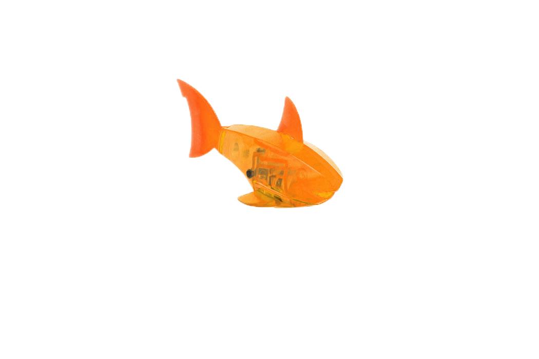 Микро-робот Hexbug Aquabot Shark, цвет: оранжевый460-3028_5Уникальный микро-робот Hexbug Aquabot Shark изготовлен из безопасного пластика в виде акулы. Теперь микро-роботы осваивают и водные глубины! Hexbug Aquabot Shark плавает как настоящая акула и непредсказуем в направлении движения. Опустите его в воду и он оживет! Если микро-робот замер, то достаточно просто всколыхнуть воду и он снова поплывет. Вне воды он автоматически выключается. Для работы игрушки необходимы 2 батарейки типа LR44 (товар комплектуется демонстрационными).