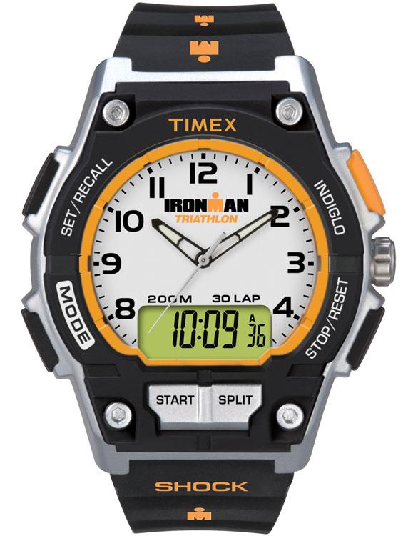 Часы наручные мужские Timex Ironman Combo 30, цвет: черный, серый, оранжевый. T5K200T5K200Стильные мужские наручные часы Timex Ironman Combo 30 - это выбор стильных и активных людей. Корпус выполнен из прочного пластика. Изделие имеет аналогово-цифровой циферблат. Циферблат дополнен арабскими цифрами, отметками, часовой, минутной и секундной стрелками. Часы оснащены кварцевым механизмом, устойчивым к царапинам пластиковым стеклом, подсветкой циферблата Indiglo и подсветкой стрелок. Также часы оснащены будильником, индикатором дня, месяца и дня недели, cплит-хронографом на 100 часов, с памятью на 30 кругов, 99 позициями счетчика, таймером обратного отсчета до 24 часов, вторым часовым поясом. Модель обладает степенью влагозащиты 10 atm. Изделие дополнено ремешком из каучука, позволяющим максимально комфортно и быстро снимать и одевать часы при помощи пряжки. Часы поставляются в фирменной коробке. Современный дизайн в спортивном стиле отлично дополнит вашу утреннюю пробежку, а надежность и чувство комфорта сделает ее просто...