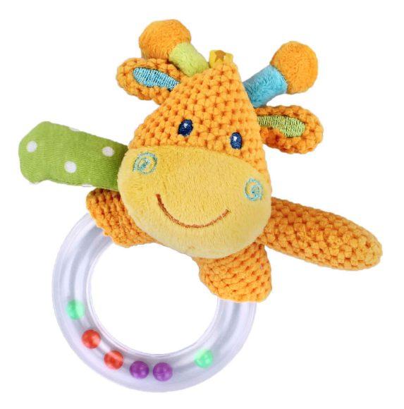 Жирафики Развивающая игрушка Погремушка Жирафик93805Погремушка - очень древняя игрушка! Наши предки считали, что погремушка помогает отогнать злых духов от детской колыбели, а сегодня специалисты утверждают, что игрушка развивает слуховое, пространственное и зрительное восприятие, а также тактильные ощущения, учит находить источник звука, сосредотачиваться и следить за движением. При встряхивании погремушка издает характерный приятный звук. Малыш с интересом будет следить за разноцветными шариками внутри колечка.