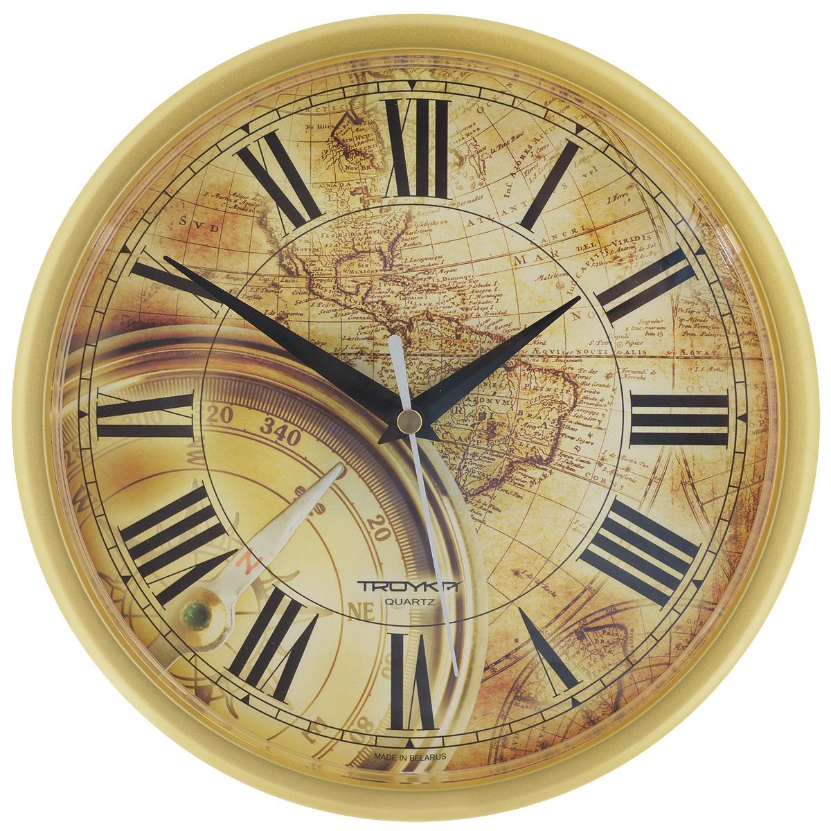 Часы настенные Troyka Компас, цвет: золотистый, светло-коричневый. 9197192691971926Настенные кварцевые часы Troyka Компас, изготовленные из пластика, прекрасно подойдут под интерьер вашего дома. Круглые часы имеют три стрелки: часовую, минутную и секундную, циферблат украшен изображением компаса на фоне старинной карты и защищен прозрачным пластиком. Диаметр часов: 22,5 см. Часы работают от 1 батарейки типа АА напряжением 1,5 В (входит в комплект).
