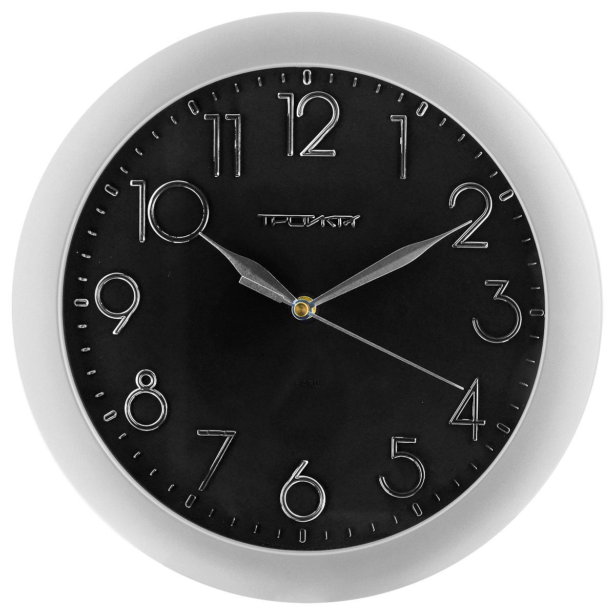 Часы настенные Troyka, цвет: серебристый, черный. 1117018211170182Настенные кварцевые часы с классическим дизайном Troyka, изготовленные из пластика, прекрасно подойдут под интерьер вашего дома. Круглые часы имеют три стрелки: часовую, минутную и секундную, циферблат защищен прозрачным пластиком. Диаметр часов: 29 см. Часы работают от 1 батарейки типа АА напряжением 1,5 В (входит в комплект).