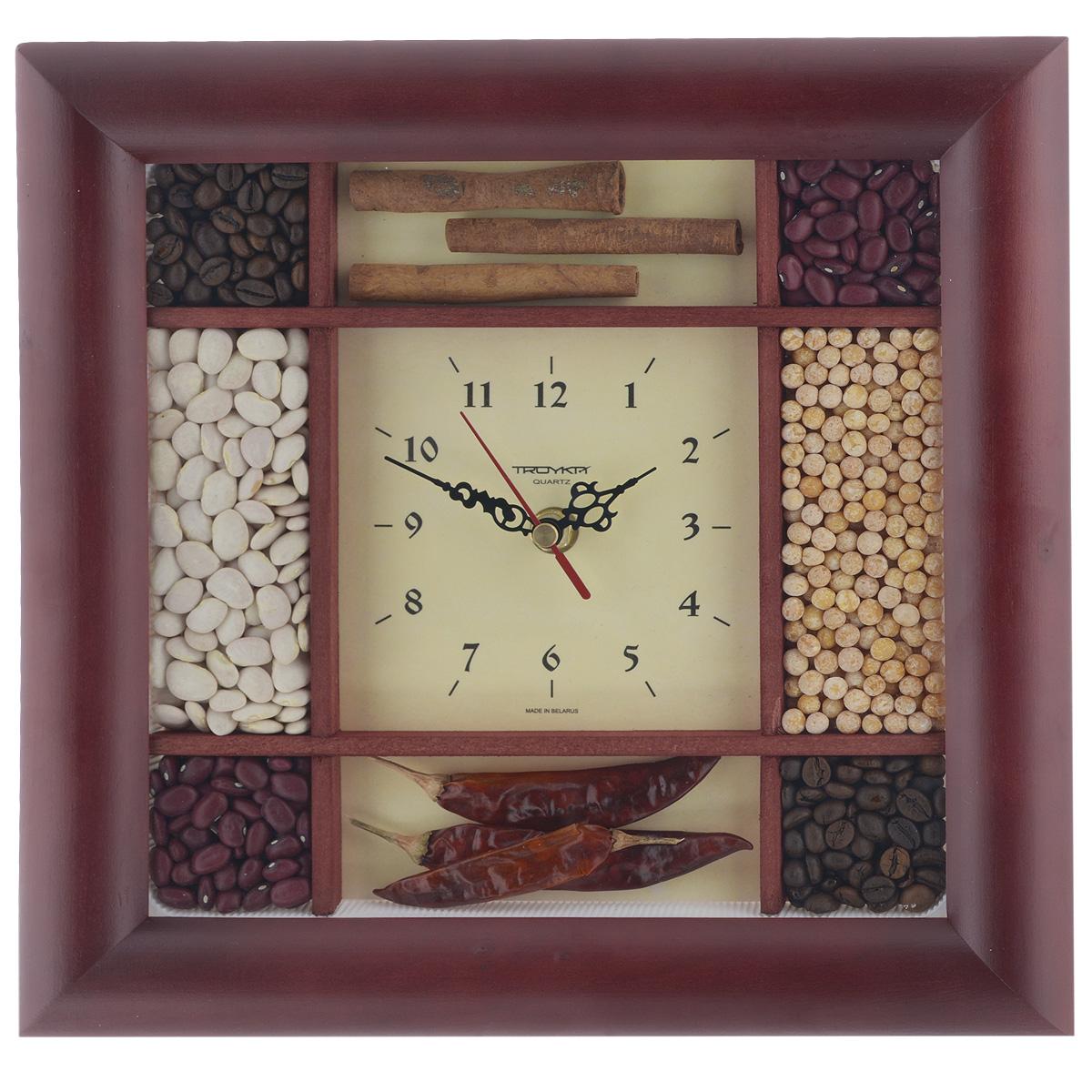 Часы настенные Troyka, цвет: светло-желтый, коричневый. 8186282881862828Настенные кварцевые часы Troyka, изготовленные из пластика, прекрасно подойдут под интерьер вашего дома. Круглые часы имеют три стрелки: часовую, минутную и секундную, циферблат имеет необычный дизайн. Он украшен семенами бобовых, таких как горох, красная и белая фасоль, а также зернами кофе, корицей и стручками перца. Циферблат защищен прозрачным пластиком. Размер часов: 29 см х 29 см. Часы работают от 1 батарейки типа АА напряжением 1,5 В (входит в комплект).