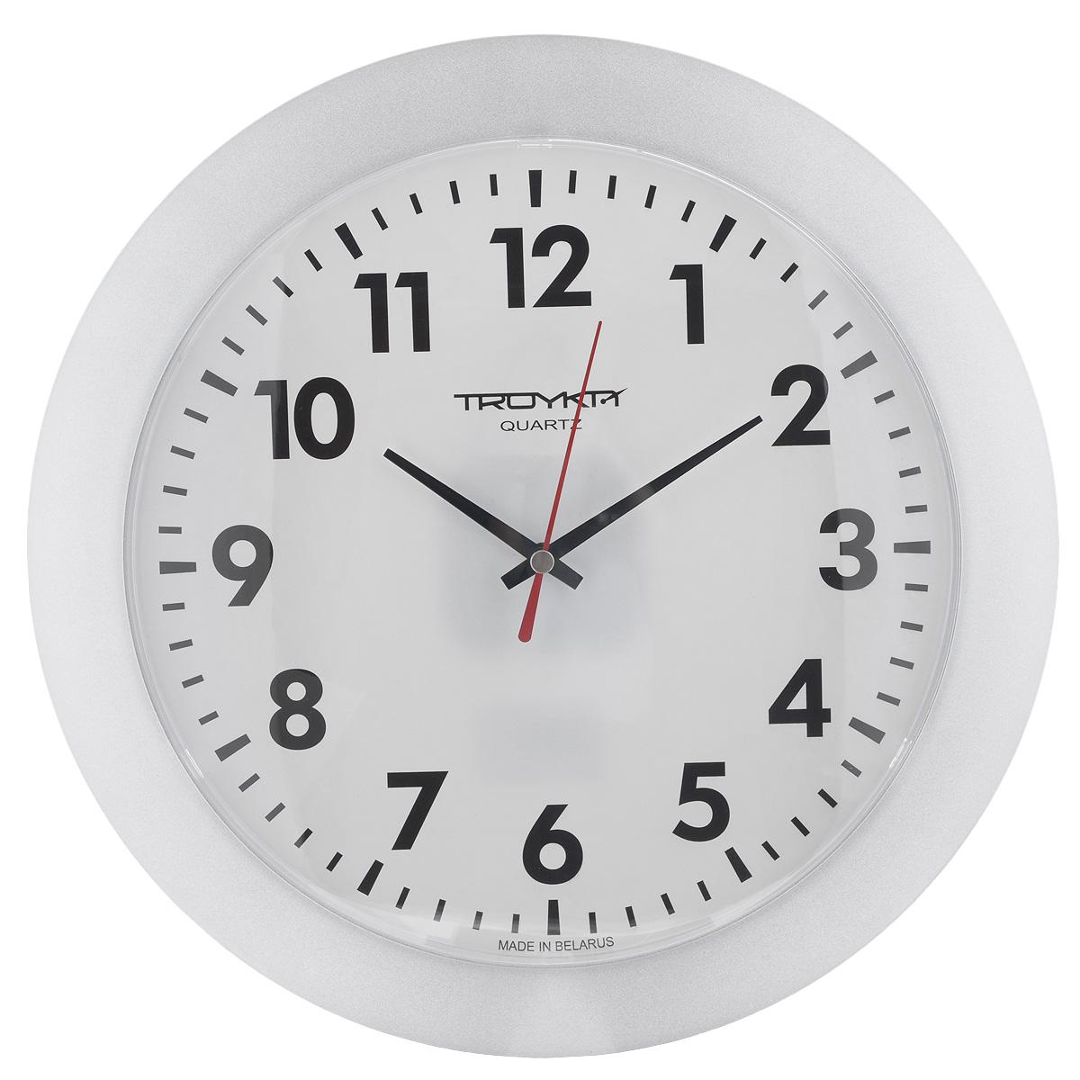 Часы настенные Troyka, цвет: белый. 5151051151510511Настенные кварцевые часы с классическим дизайном Troyka, изготовленные из пластика, прекрасно подойдут под интерьер вашего дома. Круглые часы имеют три стрелки: часовую, минутную и секундную, циферблат защищен прозрачным пластиком. Диаметр часов: 30,5 см. Часы работают от 1 батарейки типа АА напряжением 1,5 В (входит в комплект).