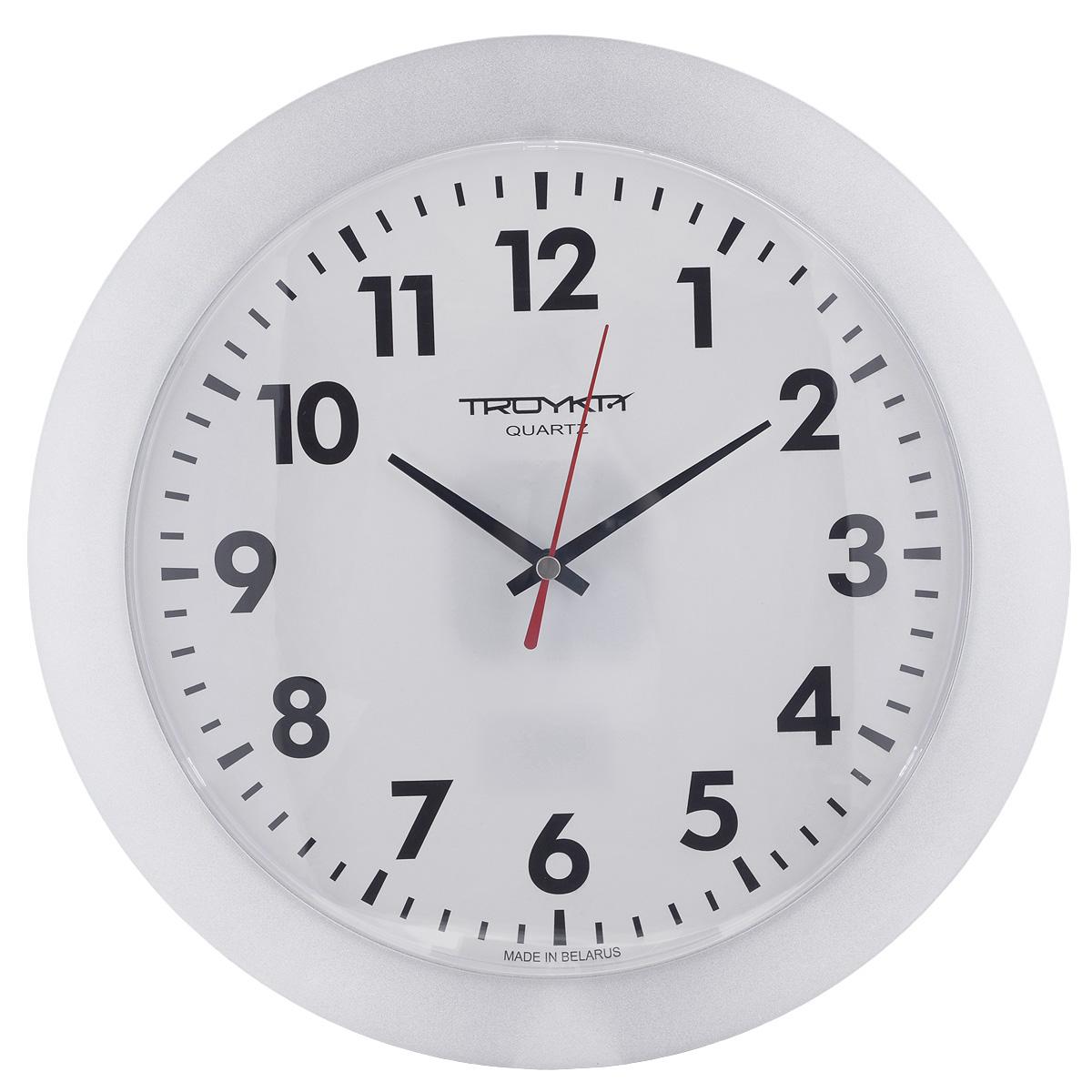 Часы настенные Troyka, цвет:серебритый. 5157051151570511Настенные кварцевые часы с классическим дизайном Troyka, изготовленные из пластика, прекрасно подойдут под интерьер вашего дома. Круглые часы имеют три стрелки: часовую, минутную и секундную, циферблат защищен прозрачным пластиком. Диаметр часов: 30,5 см. Часы работают от 1 батарейки типа АА напряжением 1,5 В (входит в комплект).