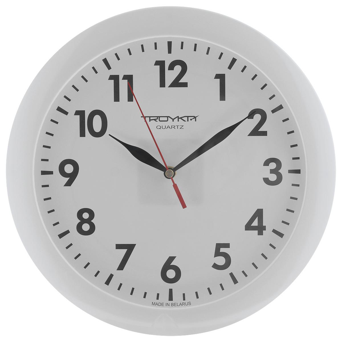 Часы настенные Troyka, цвет: белый. 1111011811110118Настенные кварцевые часы с классическим дизайном Troyka, изготовленные из пластика, прекрасно подойдут под интерьер вашего дома. Круглые часы имеют три стрелки: часовую, минутную и секундную, циферблат защищен прозрачным пластиком. Диаметр часов: 29 см. Часы работают от 1 батарейки типа АА напряжением 1,5 В (входит в комплект).