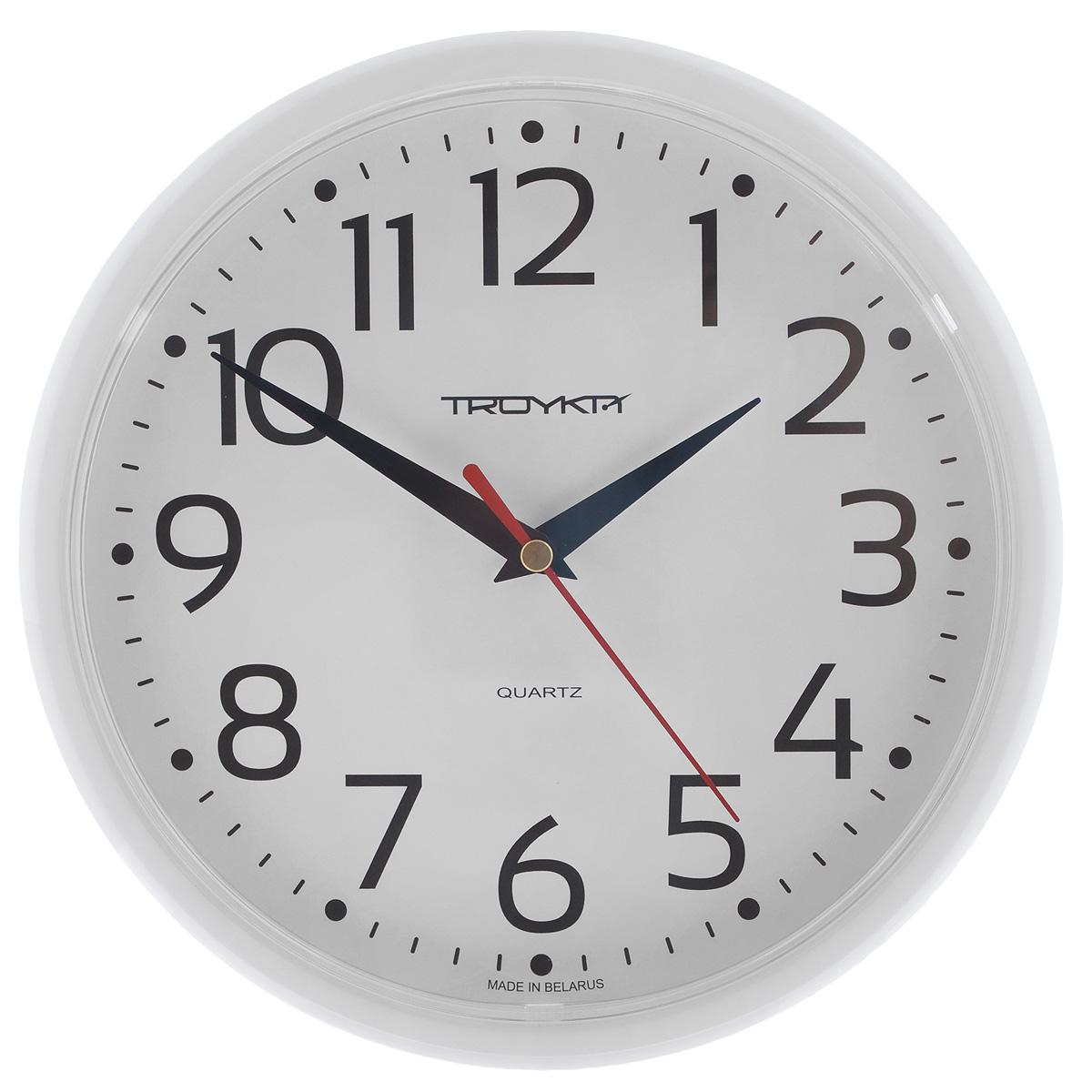 Часы настенные Troyka, цвет: белый. 9191091291910912Настенные кварцевые часы с классическим дизайном Troyka, изготовленные из пластика, прекрасно подойдут под интерьер вашего дома. Круглые часы имеют три стрелки: часовую, минутную и секундную, циферблат защищен прозрачным пластиком. Диаметр часов: 22,5 см. Часы работают от 1 батарейки типа АА напряжением 1,5 В (входит в комплект).