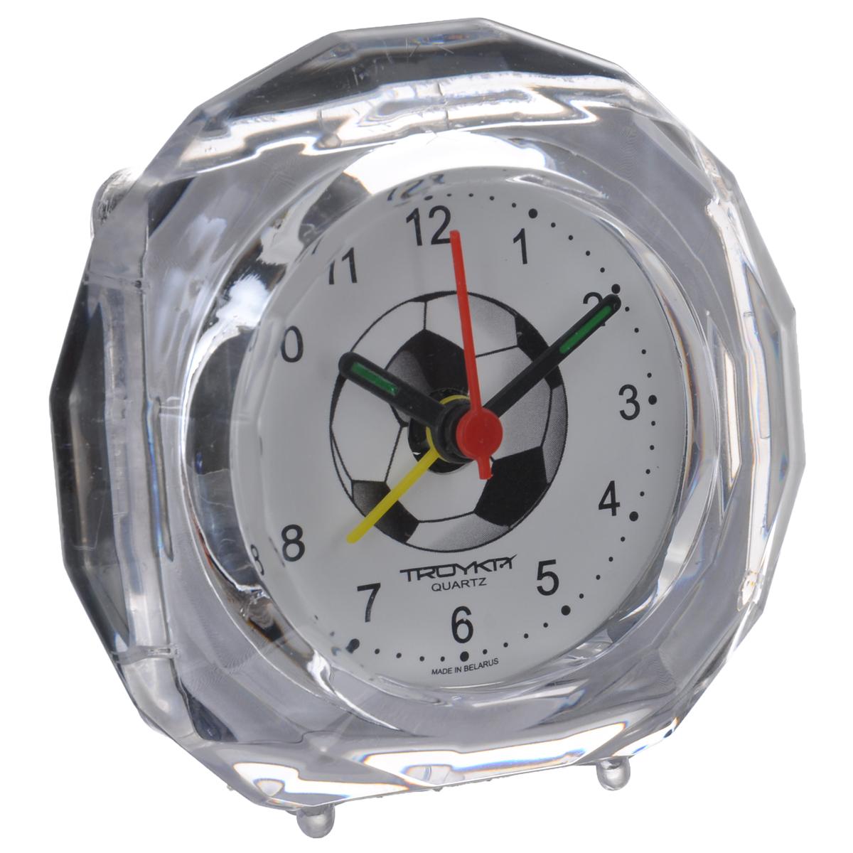 Будильник Troyka, цвет: прозрачный. 02.01702.017Будильник Troyka выполнен из стекла и пластика. Он поможет вам просыпаться по утрам и никуда не опаздывать. Циферблат украшен изображением футбольного мяча. На задней панели будильника расположены переключатель включения/выключения механизма и два колесика для настройки текущего времени и времени звонка будильника. Будильник работает от 1 батарейки типа AA (не входит в комплект).