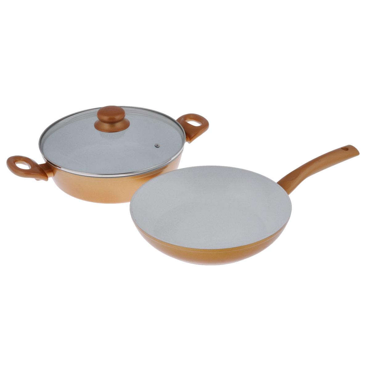Набор посуды Korkmaz Serena, c керамическим покрытием, цвет: золотистый, белый, 3 предметаA1570-1Набор Korkmaz Serena состоит из сотейника с крышкой и сковороды, изготовленных из литого высокопрочного алюминия с внутренним керамическим покрытием. При таком покрытии пища не пристает и не пригорает, масла требуется вдвое меньше по сравнению с другими покрытиями, что позволяет приготовить здоровую, вкусную и полезную пищу без лишних жиров и оксидантов. Литой алюминий имеет свойство быстро нагреваться до высокой температуры и равномерно распределять тепло по всем поверхностям. Посуда не содержит тефлоновых составляющих PTFE и PFOA. Предметы набора имеют не нагревающиеся ручки из бакелита, предотвращающие появление ожогов на руках. Сотейник оснащен крышкой из жаропрочного стекла. Сотейник и сковорода пригодны для использования на газовой плите, не подходят для индукционных плит. Можно мыть в посудомоечной машине. Объем сотейника: 3,7 л. Диаметр сотейника: 26 см. Ширина сотейника (с учетом ручек): 39,5 см. ...